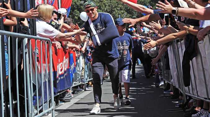 Cooper Cronk arrives to the Roosters Fan Day a battered hero. Picture: Brett Costello