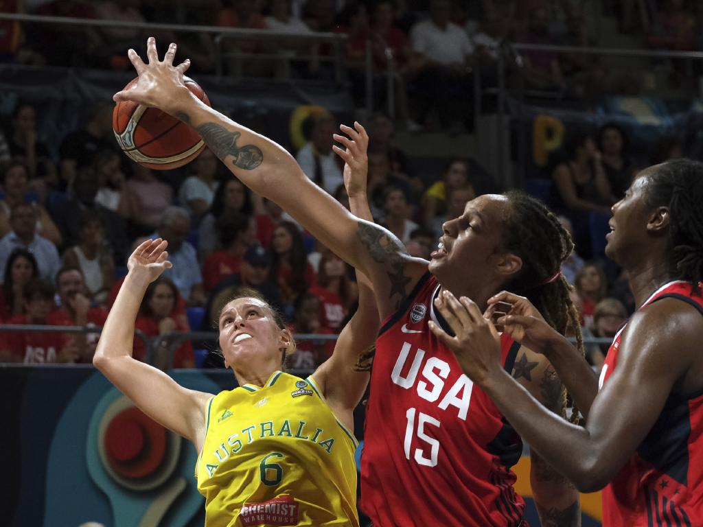 Steph Talbot of Australia, left, tries to score as Brittney Griner of the United States, centre, blocks. Picture: AP Photo