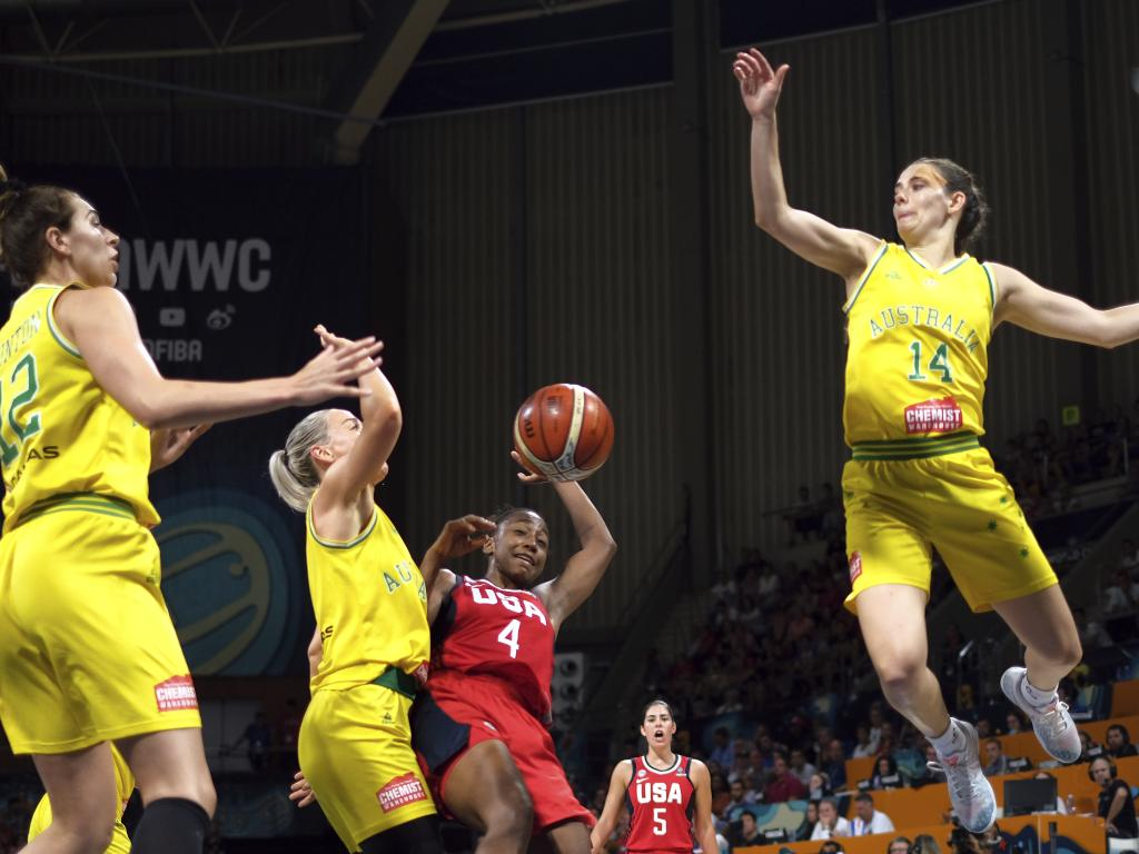 Jewell Loyd of the United States, second right, and Alanna Smith of Australia, second left, fight for the ball. Picture: AP Photo