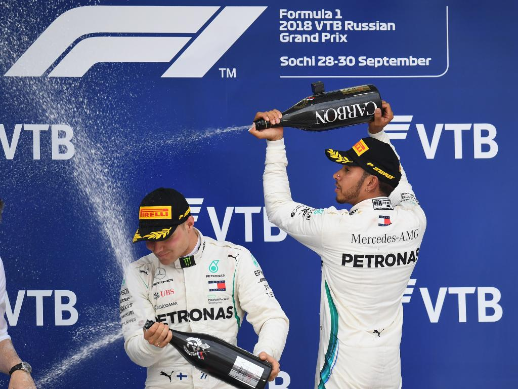 Three years ago a fearless Hamilton had soaked Putin with Champagne. Picture: Getty