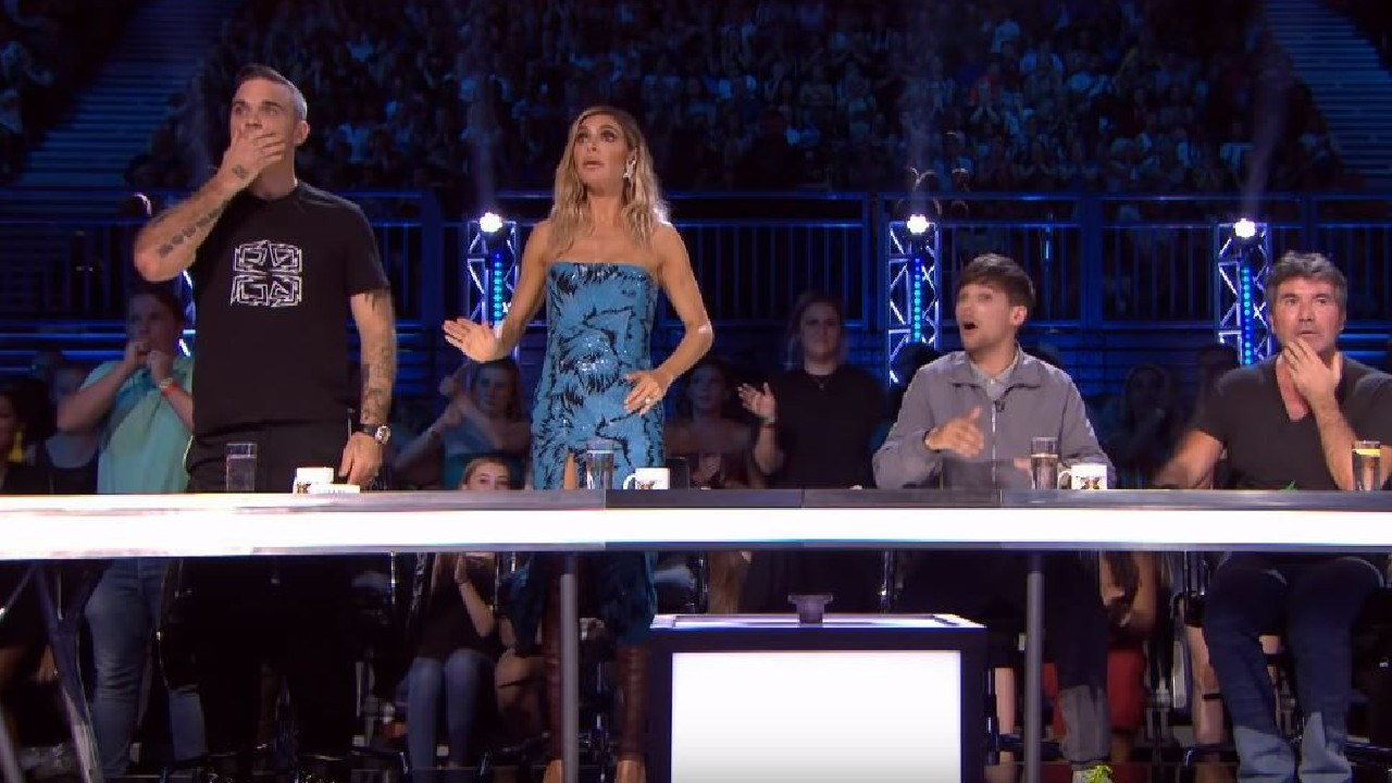 Robbie, Ayda, Louis and Simon couldn't believe their eyes.