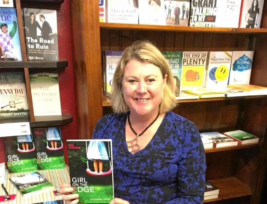 VISITING COFFS HARBOUR: Author Kim Hodges with her first book.