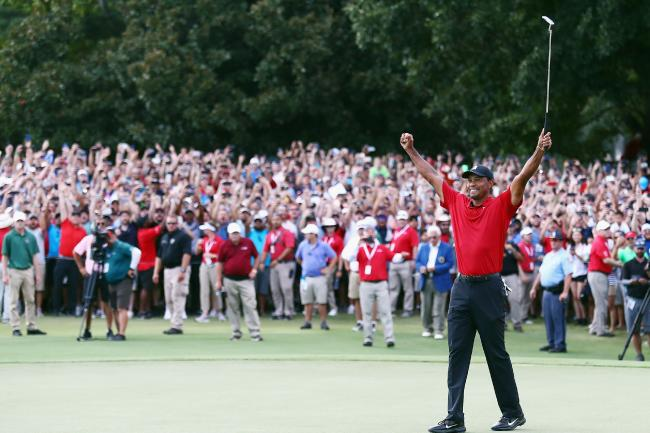 Tiger Woods celebrates after winning the Tour Championship. It was Woods first win in five years. (Picture: Tim Bradbury/Getty)