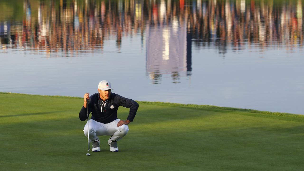 Brooks Koepka lines up a putt on the first day of the Ryder Cup.