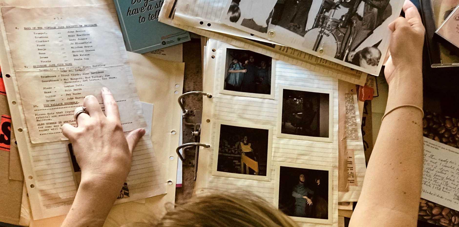ALL THAT JAZZ: Dr Lauren Istvandity looks over a scrapbook of heritage materials from the 1970s.