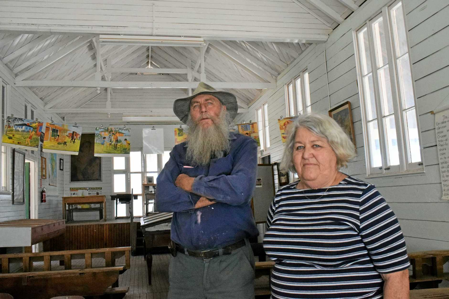 WRONGED: Chinchilla Historical Museum caretaker Oscar Lawrence and volunteer Joan Hubbard, pictured in the broken-in original Chinchilla State School, are disappointed in the recent museum theft.