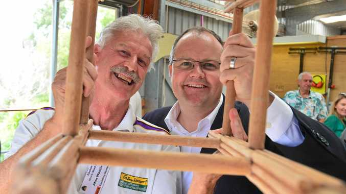 CHEERING:  Alan Wastie and MP Ted O'Brien celebrate the funding announcement for Coolum Men's Shed.