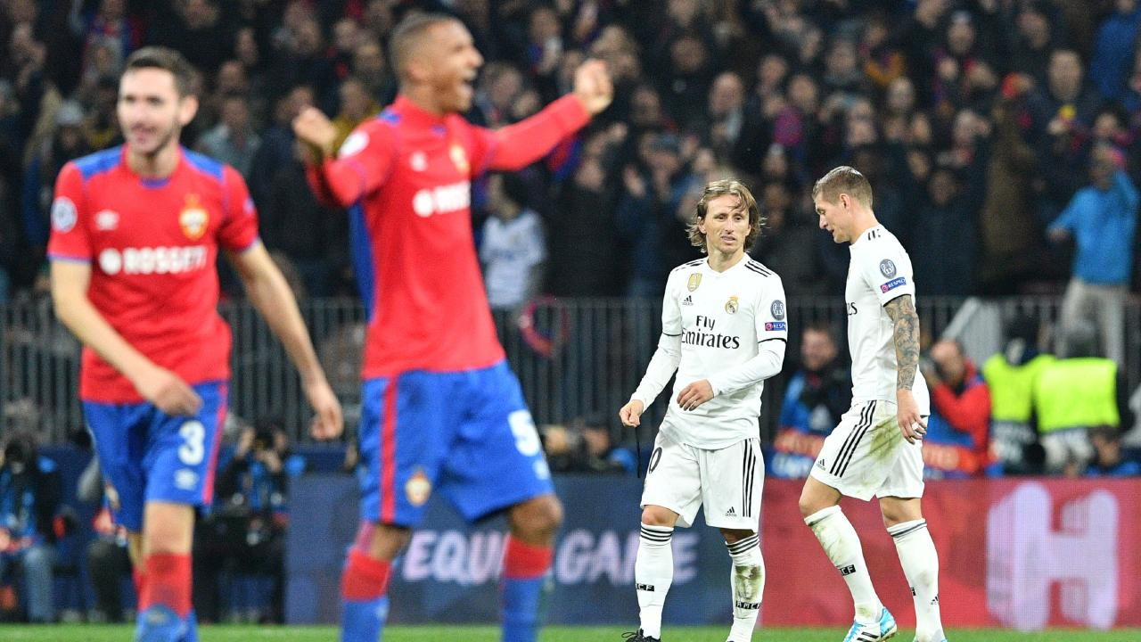 Real Madrid's Croatian midfielder Luka Modric and Real Madrid's German midfielder Toni Kroos react as CSKA Moscow's players celebrate victory