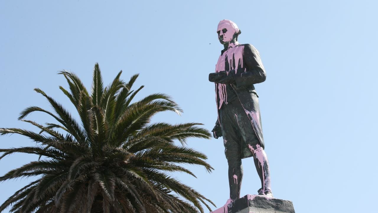 Pink paint is seen covering the head of the James Cook statue in St Kilda, Melbourne. Picture: AAP