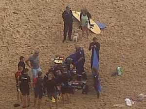Swimmer dies after being pulled from water at popular beach