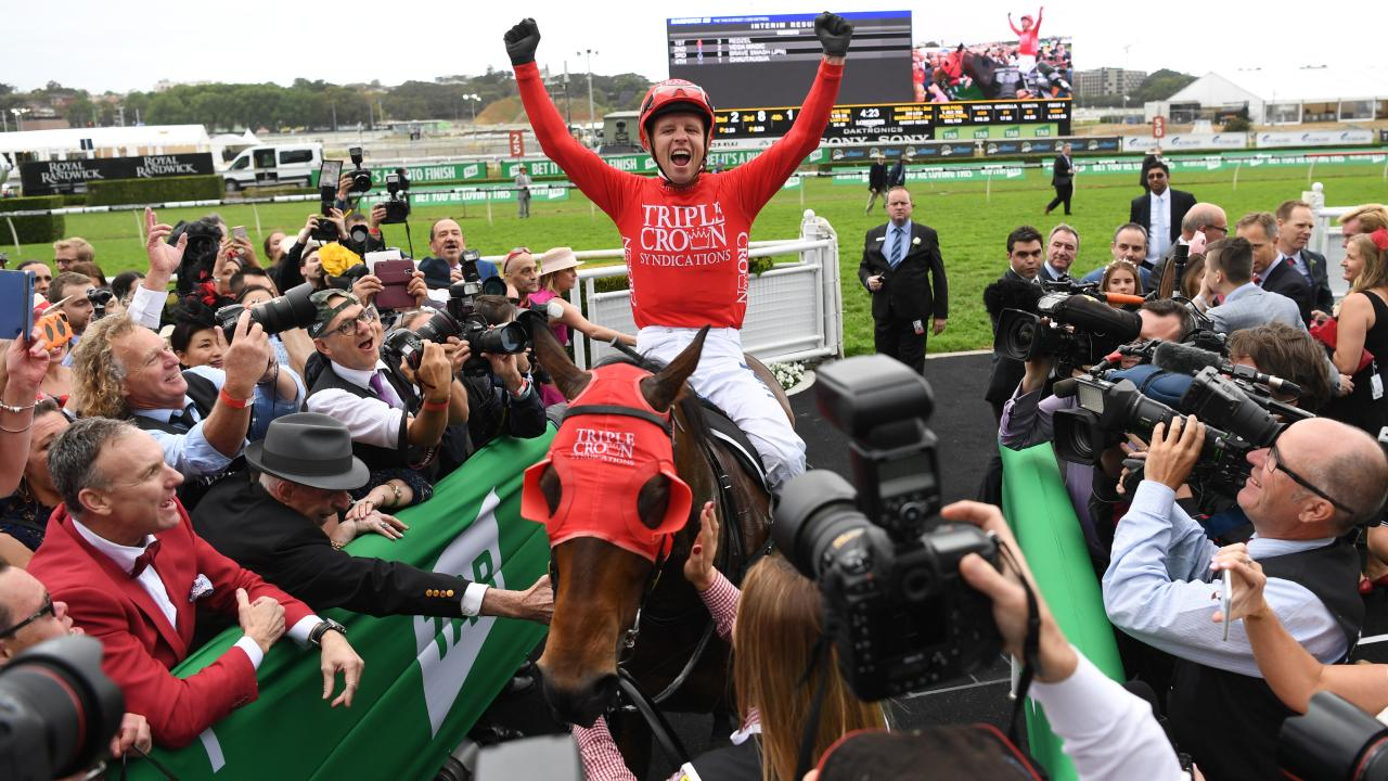 Jockey Kerrin McEvoy celebrates Redzel's victory in last year's TAB Everest. Picture: AAP