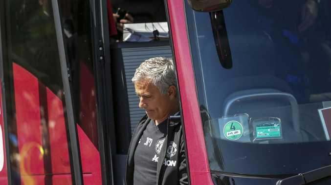 Manchester United's coach Jose Mourinho exits the team bus