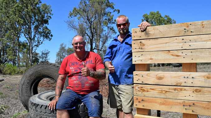 ON TARGET: Neil Gibson and Andy King working to get Bulldog Paintball up and running in Biloela.