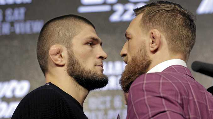 Conor McGregor, right, and Khabib Nurmagomedov pose for pictures during a news conference in New York last month. Picture: Seth Wenig/AP