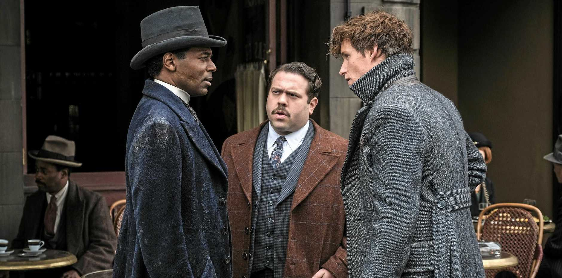 William Nadylam, Dan Fogler and Eddie Redmayne in a scene from the movie Fantastic Beasts: The Crimes of Grindelwald.