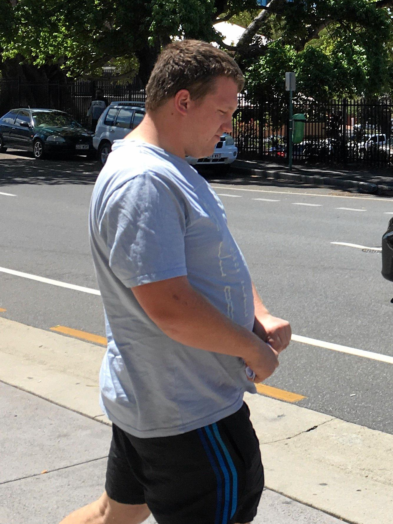 Joshua Madsen-Bennett leaves court after being convicted of fraud.