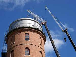 PHOTOS: Roof comes down at historic water tower