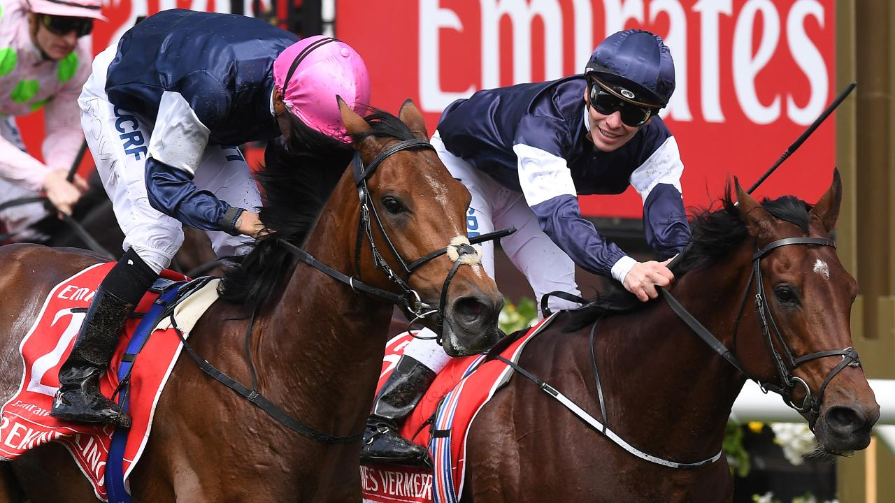 Corey Brown and Rekindling (pink cap) edge out Johannes Vermeer and Ben Melham to win last year's Melbourne Cup. Picture: AAP