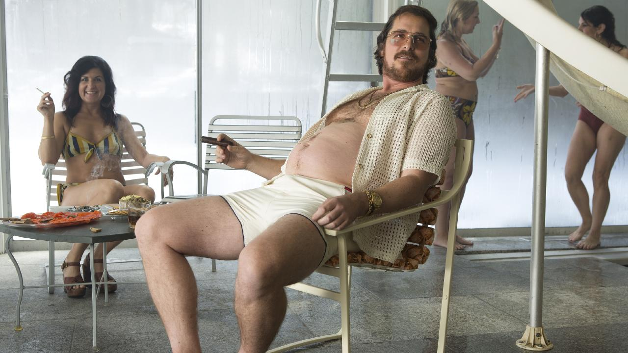 Letting it all hang out in American Hustle.