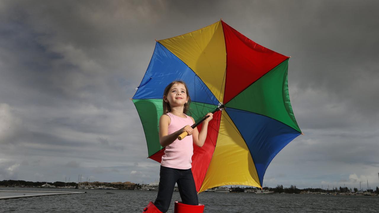 Addison Boyd, 6, from Brisbane, has her umbrella ready. Picture: Glenn Hampson