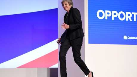 British Prime Minister Theresa May dances onto the stage to deliver her leader's speech during the final day of the Conservative Party Conference. Picture: Jeff J Mitchell/Getty Images