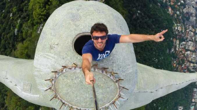 A man takes a selfie at Christ the Redeemer in Brazil. Picture: Supplied