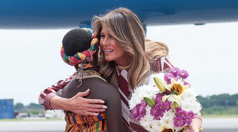 US First Lady Melania Trump receives flowers during an arrival ceremony.