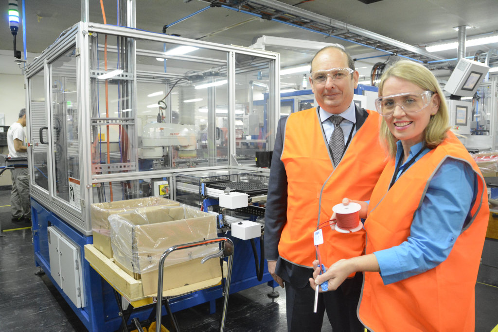 PUSH START: Industry Minister Kate Jones has launched the new electronic blasting system assembly line by Orica's factory in Helidon, represented by Australia and Asia-Pacific president Darryl Cuzzubbo.