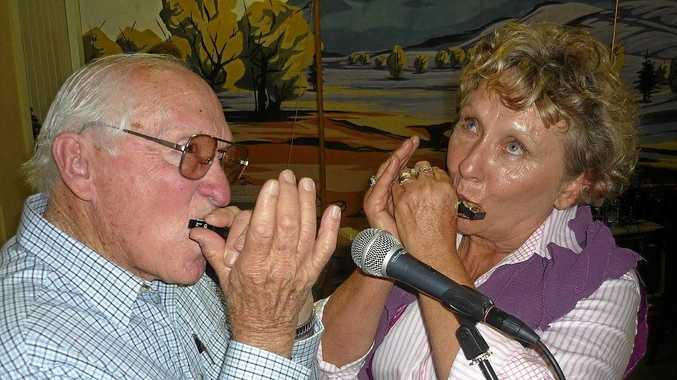 Kevin Frank and Jeanette Kummerow on the harmonica, one of numerous 'old-time' instruments joining the fun of the annual Maclagan Squeeze Box Festival.