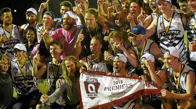 ELATED: The Gympie Cats celebrate their premiership win over the Hervey Bay Bombers at Norm McLean Oval last month.