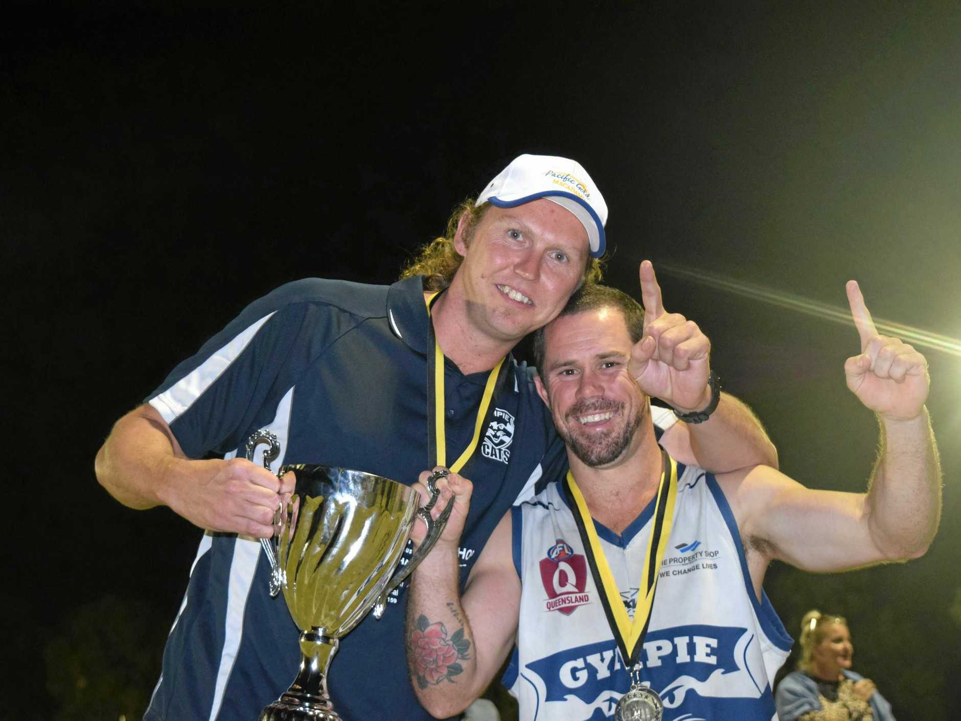 Cats premiership coach Courtney Findlay with acting captain and best on ground Scott Stiefler.