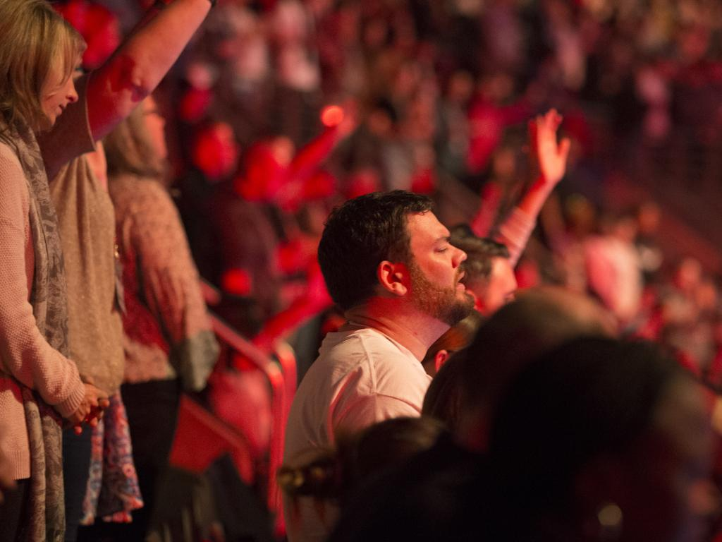 Worship inside the Hillsong conference at Homebush last year. Picture: Jenny Evans