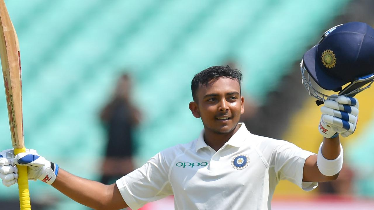 India's Prithvi Shaw celebrates after scoring a century against the West Indies. Picture: Indranil Mukherjee