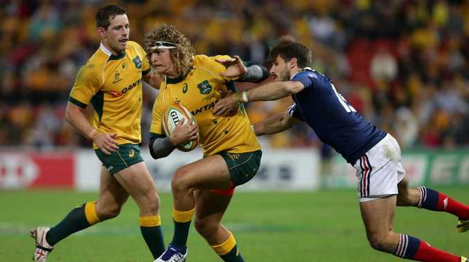 Nick Cummins playing for Australia against France. Picture: Peter Wallis
