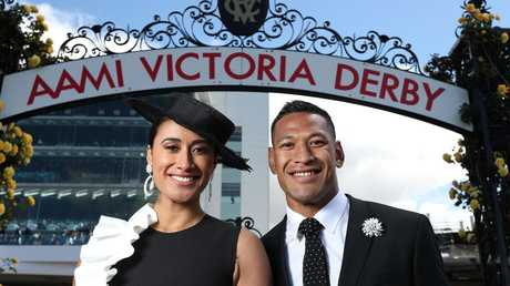 Maria and Israel Folau at the races last year. f