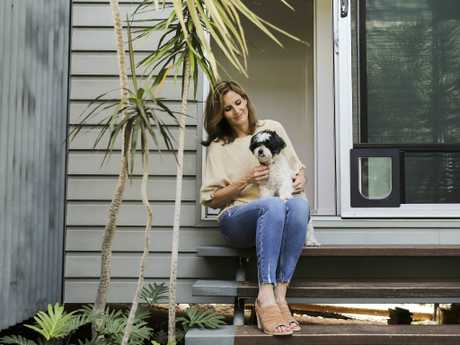 Nikki Gannon, with dog Clover, is on a mission to raise awareness about Wolff-Parkinson-White syndrome which claimed her daughter's life. Picture: Mark Cranitch