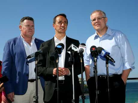 North Bondi Surf Life Saving Club president Mark Cotter, Liberal candidate for Wentworth, Dave Sharma and Prime Minister Scott Morrison speaking at a press conference at North Bondi Surf Club earlier this week. Picture: Jane Dempster