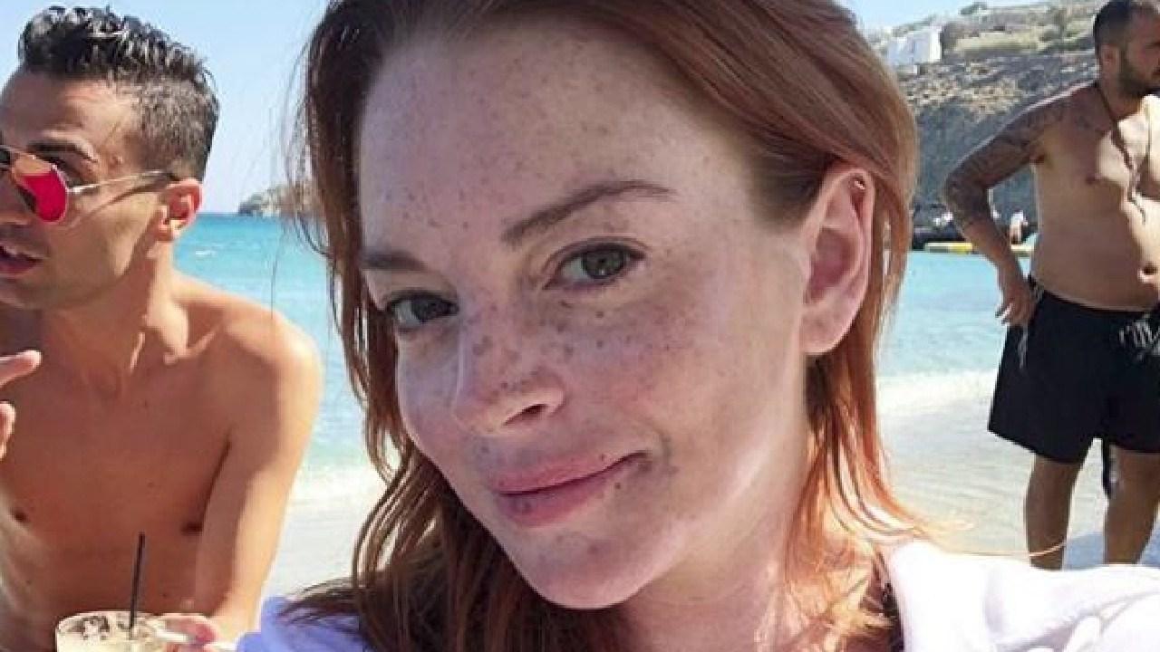 Lohan hits the beach in Mykonos.