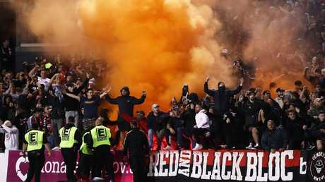 A flare is let off at Panthers Stadium on Saturday night. Picture: Getty Images