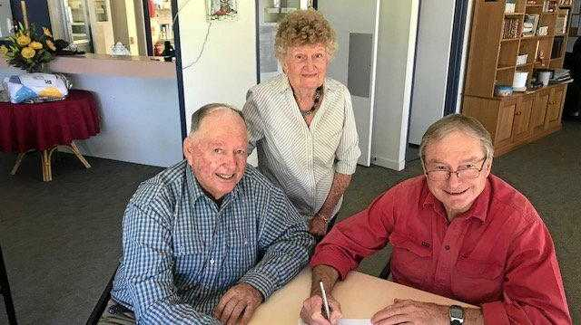 HANDOVER: Des and Doro Warrian with Howard Hobbs signing leasing documents for the Injune Retirement Village at Injune.