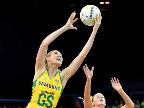 Caitlin Bassett (left) of the Diamonds soars over Katrina Grant (right) of the Silver Ferns. Picture: AAP Image
