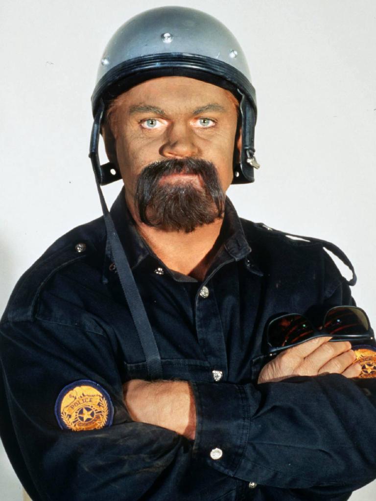 Vautin as a motorbike cop.