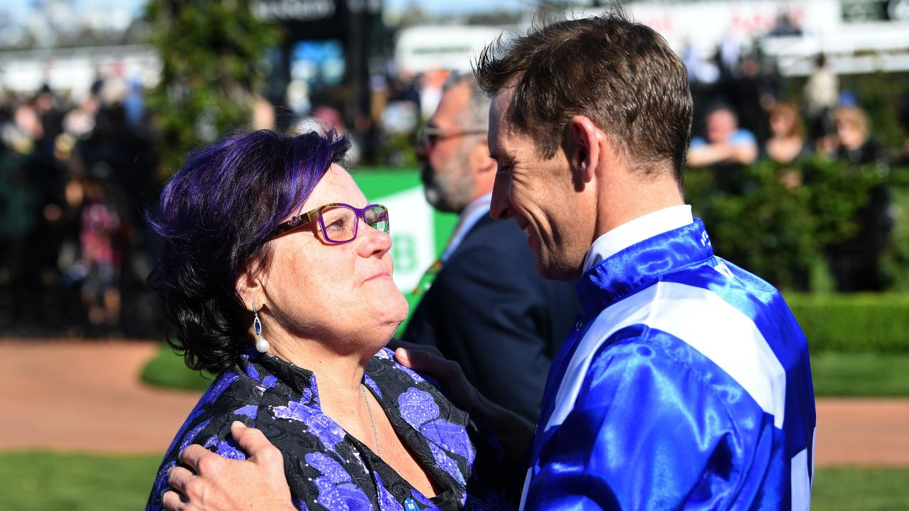 Jockey Hugh Bowman (right) and owner Debbie Kepitis react after Winx won the Turnbull Stakes during the TAB Turnbull Stakes Day at Flemington Racecourse in Melbourne, Saturday, October 6, 2018. (AAP Image/Julian Smith) NO ARCHIVING, EDITORIAL USE ONLY