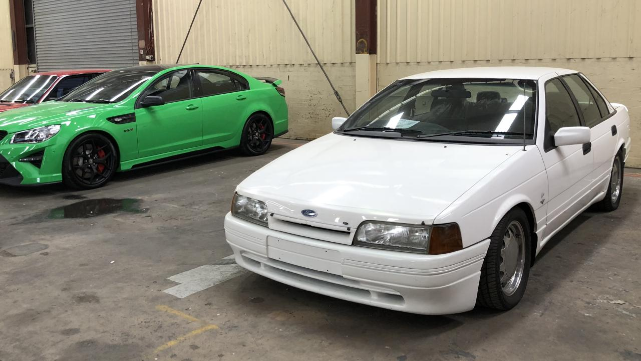 One of the cheapest cars sold, the Brock signature Falcon. The HSV W1, left, is being sold at a later auction. Picture: Joshua Dowling.