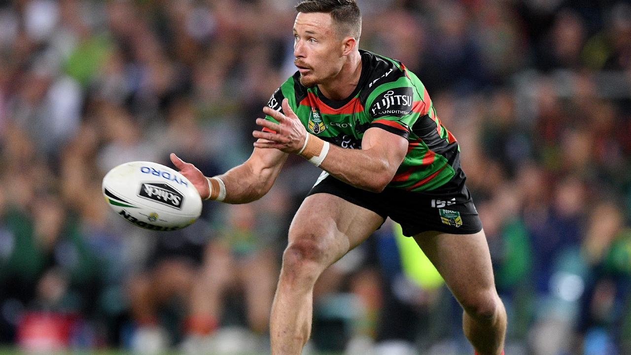 Damien Cook of the Rabbitohs passes the ball during the NRL Preliminary Final
