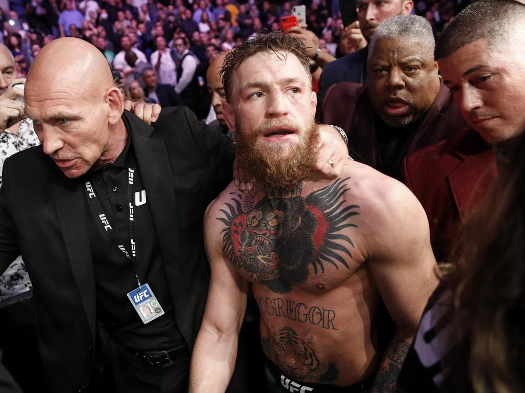 Conor McGregor is escorted from the cage area after fighting Khabib Nurmagomedov. Picture: AP Photo