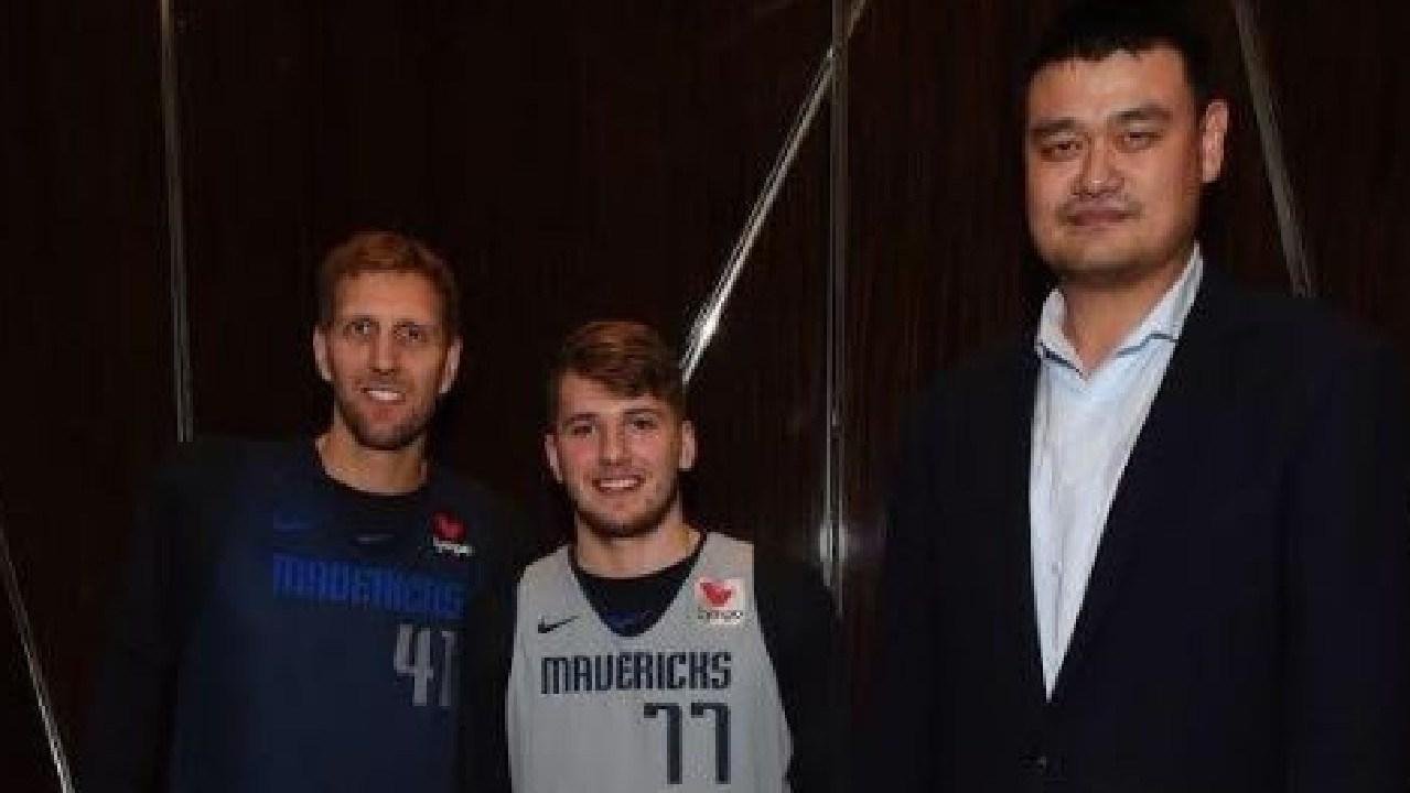 NBA stars Dirk Nowitski and Luka Doncic look tiny next to Yao Ming.