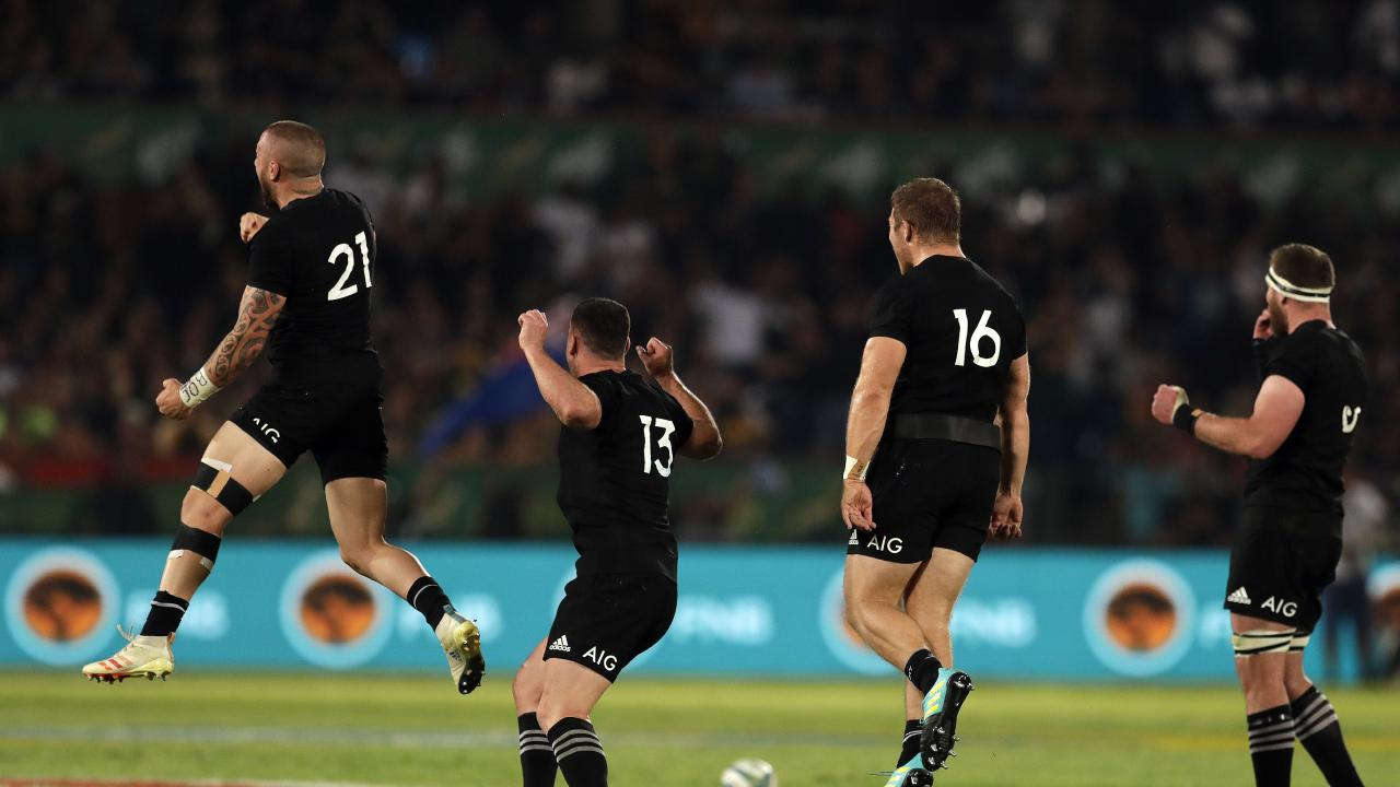 New Zealand players celebrate at the end of the Rugby Championship match.