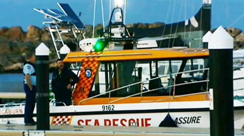 Police aboard a sea rescue boat, one of 11 vessels which searched for the missing men, finding two bodies. Picture: Sky News.