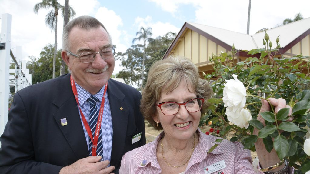 ROSY AWARD: Queensland Rose Garden president Regina Albion is proud of the display at Newtown Park winning an international accolade from the World Federation of Rose Societies, represented here by past president Kelvin Trimper.